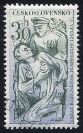 czechoslovakia: CZECHOSLOVAKIA - CIRCA 1960: stamp printed by Czechoslovakia, shows Soldier helping concentration camp victim, circa 1960