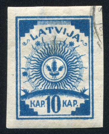 LATVIA - CIRCA 1919: stamp printed by Latvia, shows Arms, circa 1919 Stock Photo - 20527545
