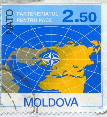 centered: MOLDOVA - CIRCA 1994: stamp printed by Moldova, shows World map centered on Europe, circa 1994 Editorial