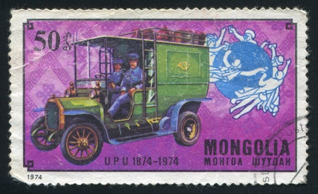 upu: MONGOLIA - CIRCA 1974: stamp printed by Mongolia, shows UPU Emblem and First Hungarian mail truck, circa 1974 Editorial