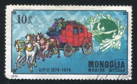 upu: MONGOLIA - CIRCA 1974: stamp printed by Mongolia, shows UPU Emblem and American Mail Coach, circa 1974 Editorial