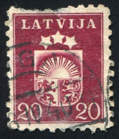 LATVIA - CIRCA 1919: stamp printed by Latvia, shows Arms, circa 1919 Stock Photo - 20527516