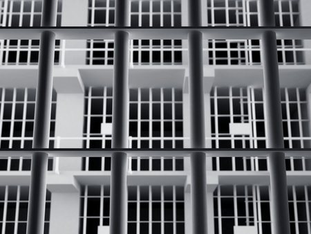 culprit: The view from the inside of a brick jail cell with iron bars. Stock Photo