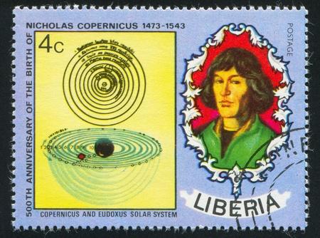 boffin: LIBERIA - CIRCA 1973: stamp printed by Liberia, shows Nicolaus Copernicus and Eudoxus solar system, circa 1973 Editorial