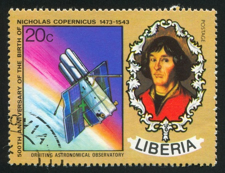 copernicus: LIBERIA - CIRCA 1973: stamp printed by Liberia, shows Nicolaus Copernicus and Orbiting astronomical observatory, circa 1973 Editorial