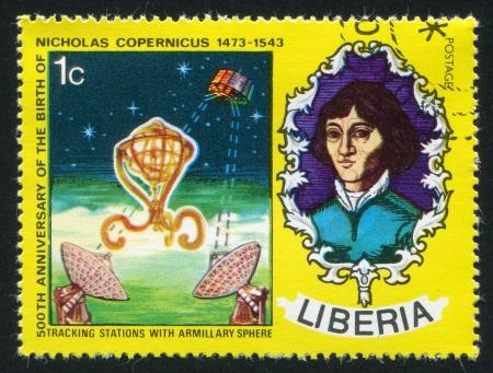boffin: LIBERIA - CIRCA 1973: stamp printed by Liberia, shows Nicolaus Copernicus, armillary sphere and satellite communication, circa 1973