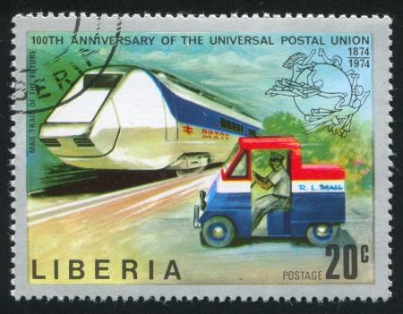 upu: LIBERIA - CIRCA 1974: stamp printed by Liberia, shows Futuristic mail train and mail truck, circa 1974