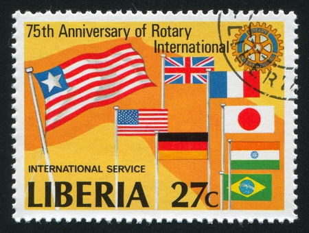 LIBERIA - CIRCA 1979: stamp printed by Liberia, shows Rotary emblem and flags, circa 1979