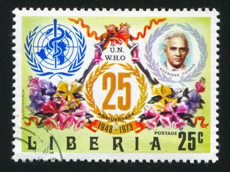 LIBERIA - CIRCA 1973: stamp printed by Liberia, shows WHO Emblem, Alexander Fleming and tree mallows, circa 1973