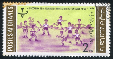 showground: AFGHANISTAN - CIRCA 1963: stamp printed by Afghanistan, shows Children, circa 1963