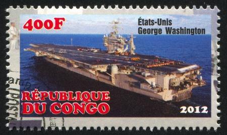 CONGO - CIRCA 2012: stamp printed by Congo, shows aircraft carrier, circa 2012