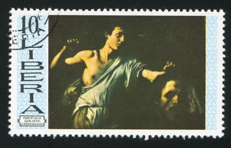 david and goliath: LIBERIA - CIRCA 1969: stamp printed by Liberia, shows David and Goliath by Caravaggio, circa 1969