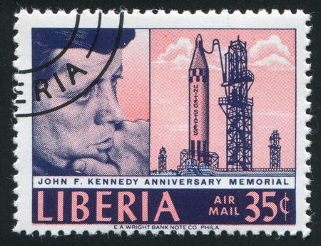 astronautics: LIBERIA - CIRCA 1966: stamp printed by Liberia, shows John Kennedy and rocket on launching pad, circa 1966