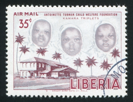 LIBERIA - CIRCA 1957: stamp printed by Liberia, shows The Kamara triplet, circa 1957