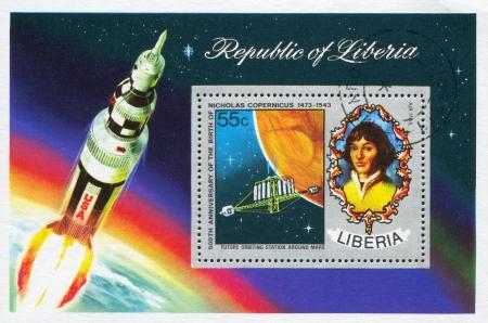 savant: LIBERIA - CIRCA 1973: stamp printed by Liberia, shows Nicolaus Copernicus and concept of orbiting station around Mars, circa 1973