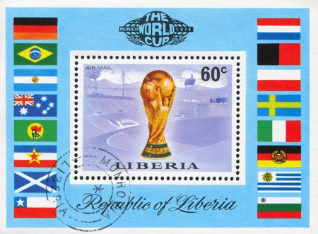 LIBERIA - CIRCA 1974: stamp printed by Liberia, shows Worls soccer championship cup, Munich stadium and flags, circa 1974