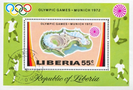 uppers: LIBERIA - CIRCA 1972: stamp printed by Liberia, shows Olympic stadium, footballers and emblem, circa 1972