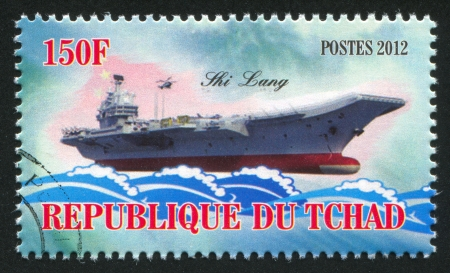 CHAD - CIRCA 2012: stamp printed by Chad, shows aircraft carrier, circa 2012