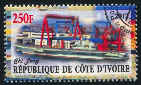 IVORY COAST CIRCA 2012: stamp printed by Ivory Coast, shows aircraft carrier, circa 2012