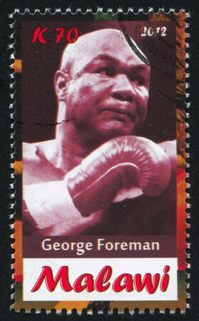 Malawi - CIRCA 2012: stamp printed by Malawi, shows George Foreman, circa 2012