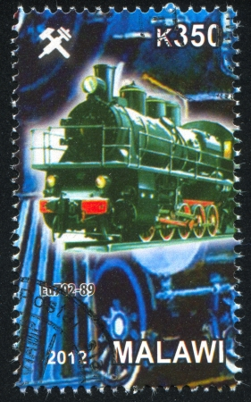Malawi - CIRCA 2012: stamp printed by Malawi, shows Steam locomotive, circa 2012 Stock Photo - 23384329