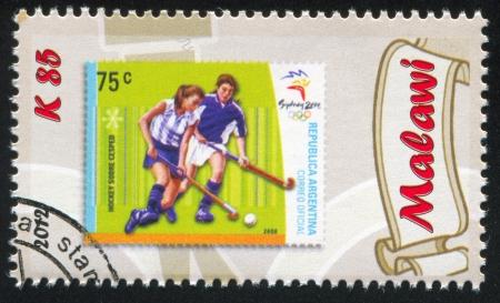 gaiters: MALAWI - CIRCA 2012: stamp printed by Malawi, shows Field Hockey, circa 2012