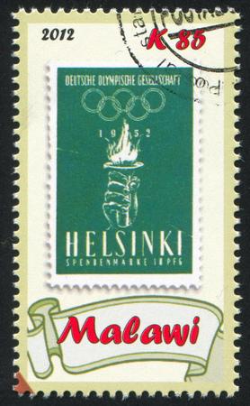 handbreadth: MALAWI - CIRCA 2012: stamp printed by Malawi, shows Torch, circa 2012 Editorial