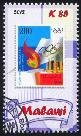 flambeau: MALAWI - CIRCA 2012: stamp printed by Malawi, shows Torch and olympic flag, circa 2012