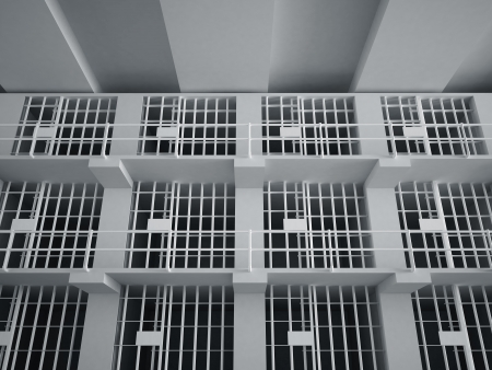 pokey: The view from the inside of a brick jail cell with iron bars. Stock Photo
