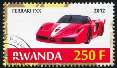 motosport: RWANDA - CIRCA 2012: stamp printed by Rwanda, shows Ferrari, circa 2012