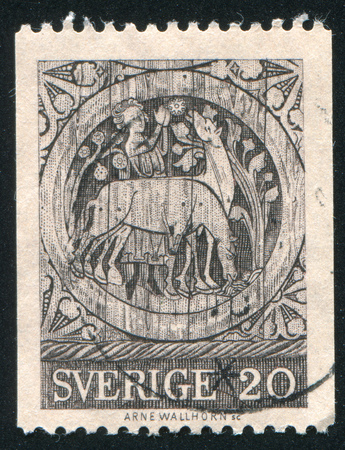 SWEDEN - CIRCA 1970: stamp printed by Sweden, shows St. Stephen as a boy tending horses, medallion from Dadesio Church, circa 1970