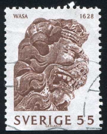 salvaging: SWEDEN - CIRCA 1969: stamp printed by Sweden, shows Crowned lion, Woodcarving, circa 1969