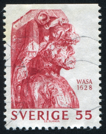 salvaging: SWEDEN - CIRCA 1969: stamp printed by Sweden, shows Man Head, Woodcarving, circa 1969
