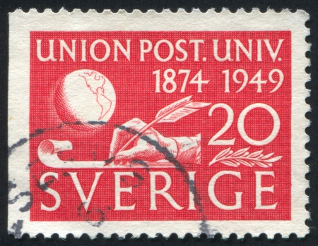united states postal service: SWEDEN - CIRCA 1949: stamp printed by Sweden, shows Hand and globe, circa 1949