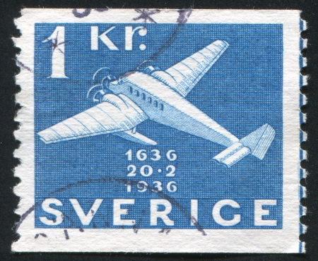 SWEDEN - CIRCA 1936: stamp printed by Sweden, shows Junkers Plane with Pontoons, circa 1936