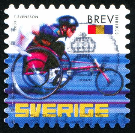 SWEDEN - CIRCA 2003: stamp printed by Sweden, shows Wheelchair racer, circa 2003