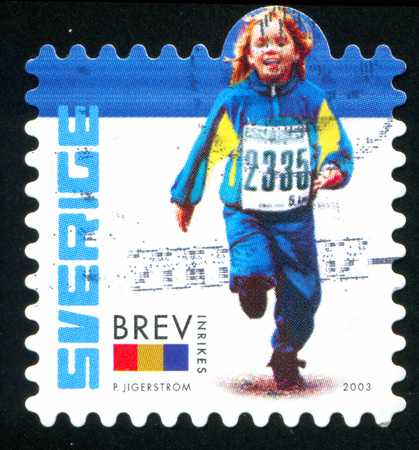 SWEDEN - CIRCA 2003: stamp printed by Sweden, shows Girl running, circa 2003 Stock Photo - 25053784
