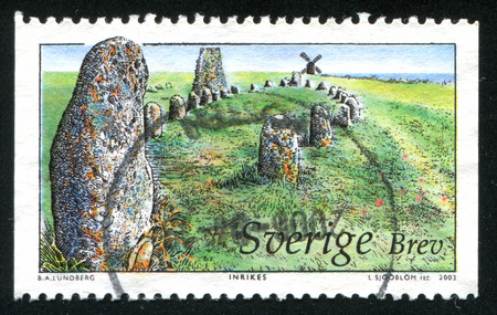 oland: SWEDEN - CIRCA 2003: stamp printed by Sweden, shows Megaliths and windmill in Oland Moorland, circa 2003 Editorial