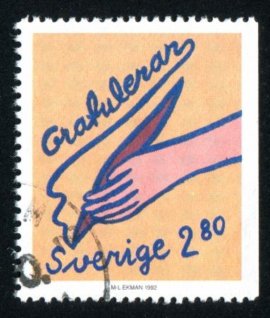 SWEDEN - CIRCA 1992: stamp printed by Sweden, shows Hand holding pen, circa 1992