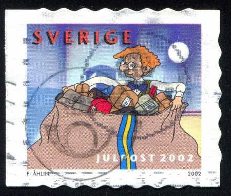 SWEDEN - CIRCA 2002: stamp printed by Sweden, shows Karl-Bertil and mail sack of Christmas parcels, circa 2002