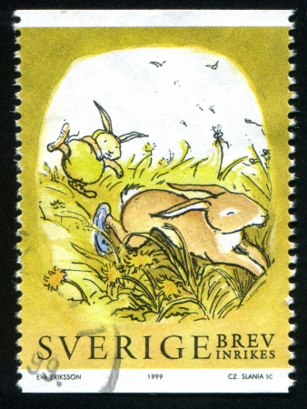 the thicket: SWEDEN - CIRCA 1999: stamp printed by Sweden, shows Rabbits Hopping through thicket, circa 1999