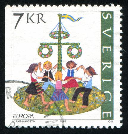 SWEDEN - CIRCA 1998: stamp printed by Sweden, shows Dancing around maypole, Midsummer in June, circa 1998