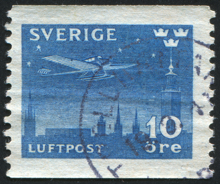 SWEDEN - CIRCA 1930: stamp printed by Sweden, shows Airplane over Stockholm, circa 1930