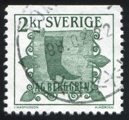 heelpiece: SWEDEN - CIRCA 1985: stamp printed by Sweden, shows Trade sign of shoemaker in Norrkoping, circa 1985