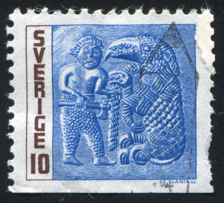 fettered: SWEDEN - CIRCA 1967: stamp printed by Sweden, shows Man with Axe and Fettered Beast, circa 1967