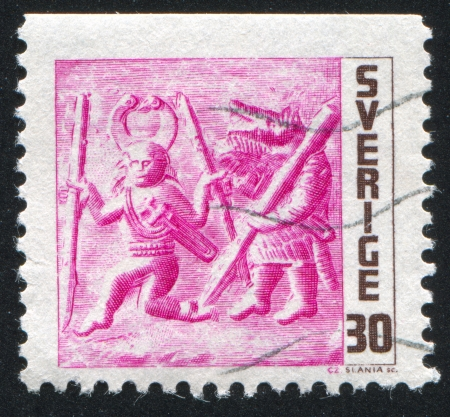 pursuing: SWEDEN - CIRCA 1967: stamp printed by Sweden, shows Warrior disguised as wolf pursuing enemy, circa 1967 Editorial