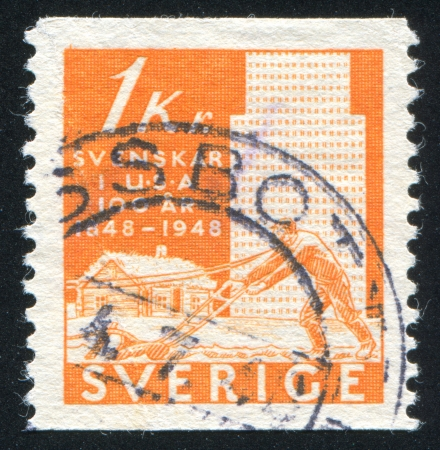 sulcus: SWEDEN - CIRCA 1948: stamp printed by Sweden, shows Plowman and buildings, circa 1948
