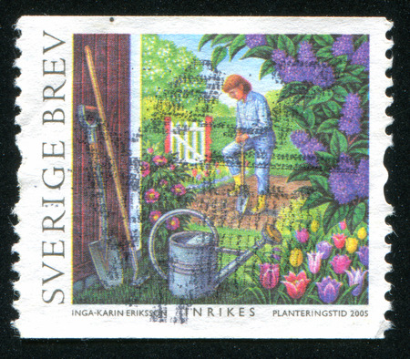 tending: SWEDEN - CIRCA 2005: stamp printed by Sweden, shows Man tending vegetable garden, circa 2005 Editorial