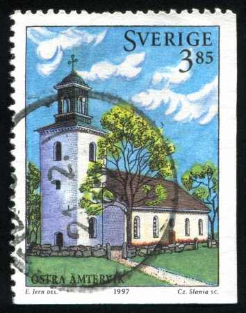 christanity: SWEDEN - CIRCA 1997: stamp printed by Sweden, shows Ostra Amtervik Church, circa 1997 Editorial