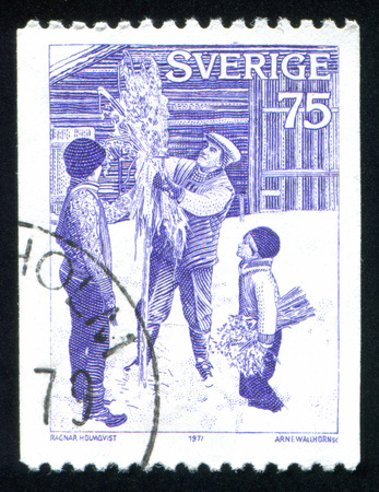 SWEDEN - CIRCA 1977: stamp printed by Sweden, shows Putting up sheaf, circa 1977 Stock Photo - 25219224